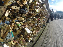 Love padlocks on Pont des Arts bridge, Seine river in Paris, France. Stock Image