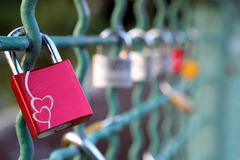 Love padlocks on a railing of bridge. On blurred background with space for text Stock Photo