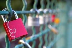 Love padlocks on a railing of bridge Stock Photo