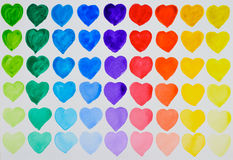 A love of painting. Rainbow watercolour hearts in rows. Stock Image