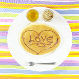 Love Pancake with sweet honey and sugar palm. On colorful background Royalty Free Stock Photos