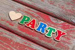 Love party sign on wooden board. Love party sign on aged wooden board royalty free stock photo
