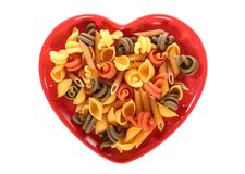 Love pasta. Pasta on a heart shape plate Royalty Free Stock Photography