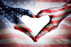 Love And Patriotism - Usa Flag. On Heart Shaped Hands Stock Photo