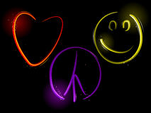 Love Peace and Happiness. Light streaks form a heart, peace sign and smiley face Royalty Free Stock Image