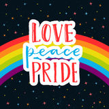 Love, peace, pride. Words on rainbow parade flag at dark sky with stars. Gay pride saying for stickers, t-shirts and Stock Photo