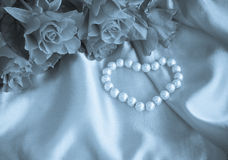 Love, pearls, roses, heart in blue. Stock Images