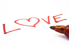 Love pen. Writing love on white background Stock Photography