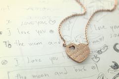 Love pendant in vintage style color. A memo writing many text meaning love in vintage style color Royalty Free Stock Photos
