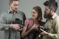 We love photo. Photography studio. Paparazzi or photojournalists with vintage old cameras. Group of photographers with. Retro cameras. Retro style women and men royalty free stock images