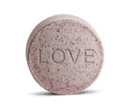 Love Pill. Pink Love Potion medicine isolated on a white background Royalty Free Stock Photos