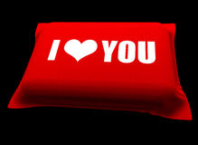 Love Pillow. A 3D red pillow with I Love You text written on it placed on a black background Royalty Free Stock Photo