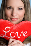 Love Pillow Woman. Beautiful woman holding love pillow Stock Photography