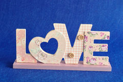 Love in pink letters  on a blue background Stock Photography