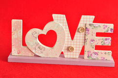 Love in pink letters isolated on a red background Stock Photo