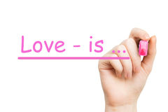 Love is ... pink marker Royalty Free Stock Photography