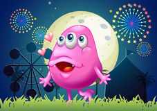 An in-love pink monster at the carnival Royalty Free Stock Image
