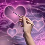 Love planet. The artist draws a love planet Royalty Free Stock Photos