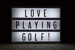 Love playing golf. `Love playing golf` text in lightbox Royalty Free Stock Photos