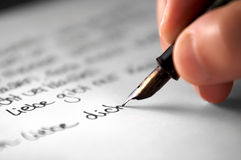 Love poem. Women´s hand writing a love poem Stock Image