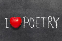 Love poetry. I love poetry phrase handwritten on blackboard with heart symbol stock images