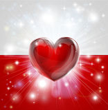 Love Poland flag heart background. Flag of Poland patriotic background with pyrotechnic or light burst and love heart in the centre Stock Photo
