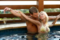 Love by the pool. Young Love by the pool Royalty Free Stock Photos