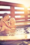 Love by the pool. Young couple in Love by the pool Stock Photo