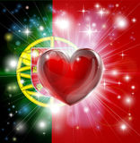 Love Portugal flag heart background. Flag of Portugal patriotic background with pyrotechnic or light burst and love heart in the centre Stock Images