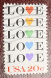 Love Postage Stamp. USA stamp that says love on it.  Great concept shot Royalty Free Stock Photography