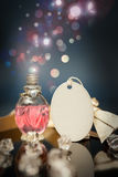 Love potion with empty key tag and bubbles in the background Stock Image