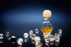 Love potion in small bottle with crystals. Yellow love potion in small bottle with crystals on the side stock photo