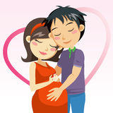 Love and Pregnancy. Man touching the belly of his pregnant wife full of love Royalty Free Stock Image