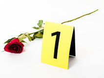 Love proof. Red rose laying near evidence no 1 card , isolated Stock Photo