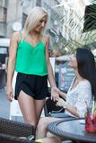 The love proposal. Lovely young women having fun in the city streets Royalty Free Stock Photos