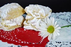 cream filled puff pastry on red heart Stock Photography