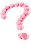Love Puzzle. Pink Heart Shape Candy and Question Mark, Love Puzzle Royalty Free Stock Images