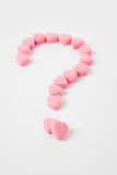 Love Puzzle. Pink Heart Shape Candy and Question Mark, Love Puzzle Stock Images