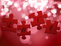 Love Puzzle. 4 red puzzle pieces with the lettering LOVE on a bokeh background Stock Photography