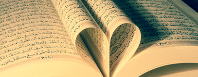 Quran love. The Quran literally meaning the recitation), also transliterated Quran, Koran, Al-Coran, Coran, Kuran, and Al-Quran, is the central religious text of Stock Images