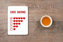 Love rating five hearts in digital tablet. Valentines day concept royalty free stock photography