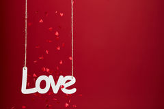 Love on red background with confetti stock images