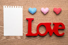 Love red gingham hearts and blank note on wooden texture background Royalty Free Stock Image