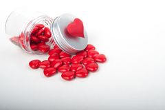 Love Red hearts background in italian style. A concept photo with some red candy hearts in a glass Royalty Free Stock Image