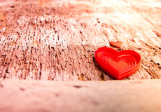 Love of red hearts on wooden background. Plastic red heart shaped boxes on wooden bacckground with some filtered effects Royalty Free Stock Photos