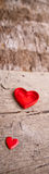 Love of red hearts on wooden background Royalty Free Stock Images