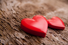Love of red hearts on wooden background Royalty Free Stock Photography