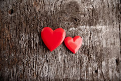 Love of red hearts on wooden background. Plastic red heart shaped boxes on wooden background with some filtered effects Royalty Free Stock Photography