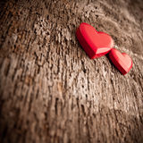 Love of red hearts on wooden background. Plastic red heart shaped boxes on wooden background with some filtered effects Stock Image