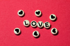 Love on red Stock Images